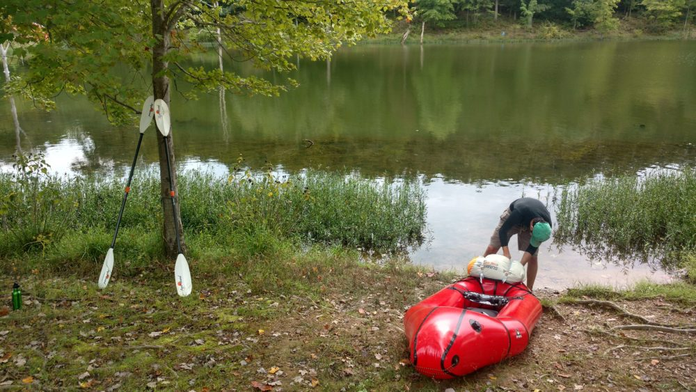 attaching a bag to the bow of a packraft
